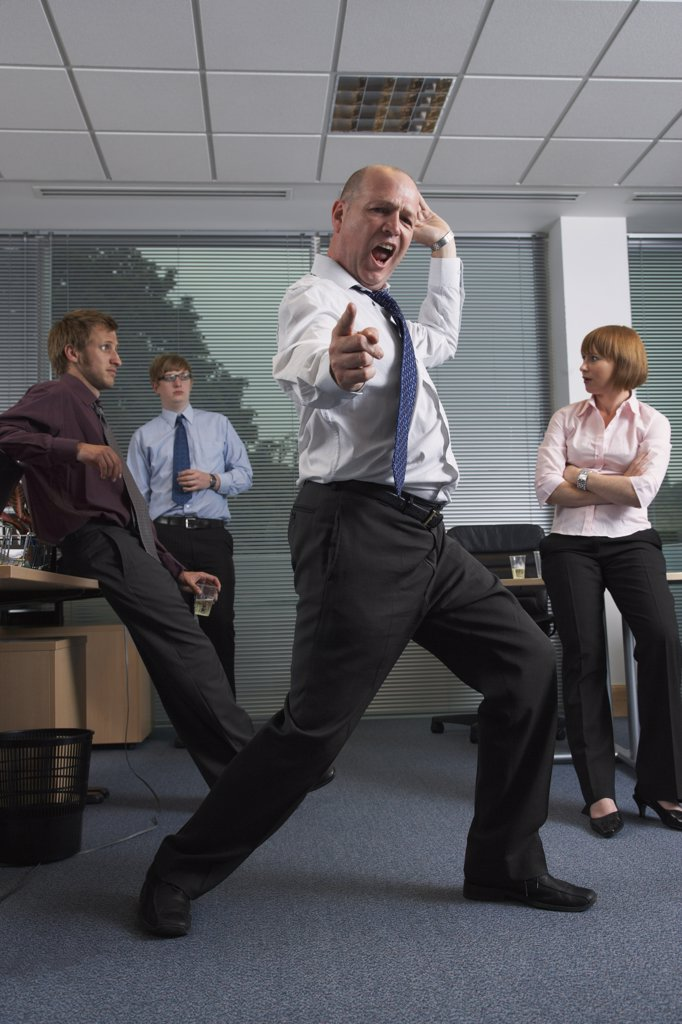 Stock Photo: 1828R-17283 Manager Dancing for Staff in Office