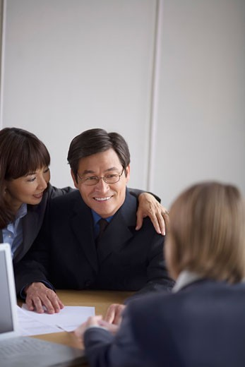 Stock Photo: 1828R-17406 Couple Meeting with Financial Advisor