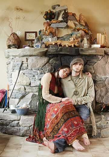 Hippie Couple in Front of Fireplace    : Stock Photo