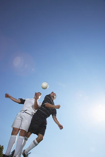 Stock Photo: 1828R-18070 Men Playing Soccer