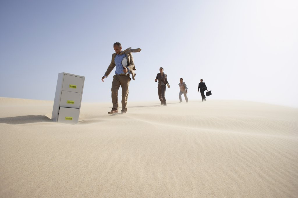 Stock Photo: 1828R-18170 Business People and Filing Cabinet in Desert