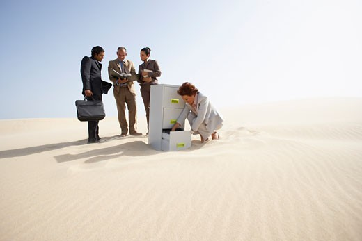 Stock Photo: 1828R-18173 Business People and Filing Cabinet in Desert