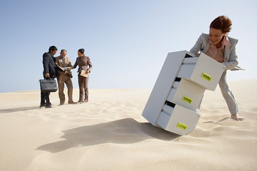 Business People and Filing Cabinet in Desert    : Stock Photo