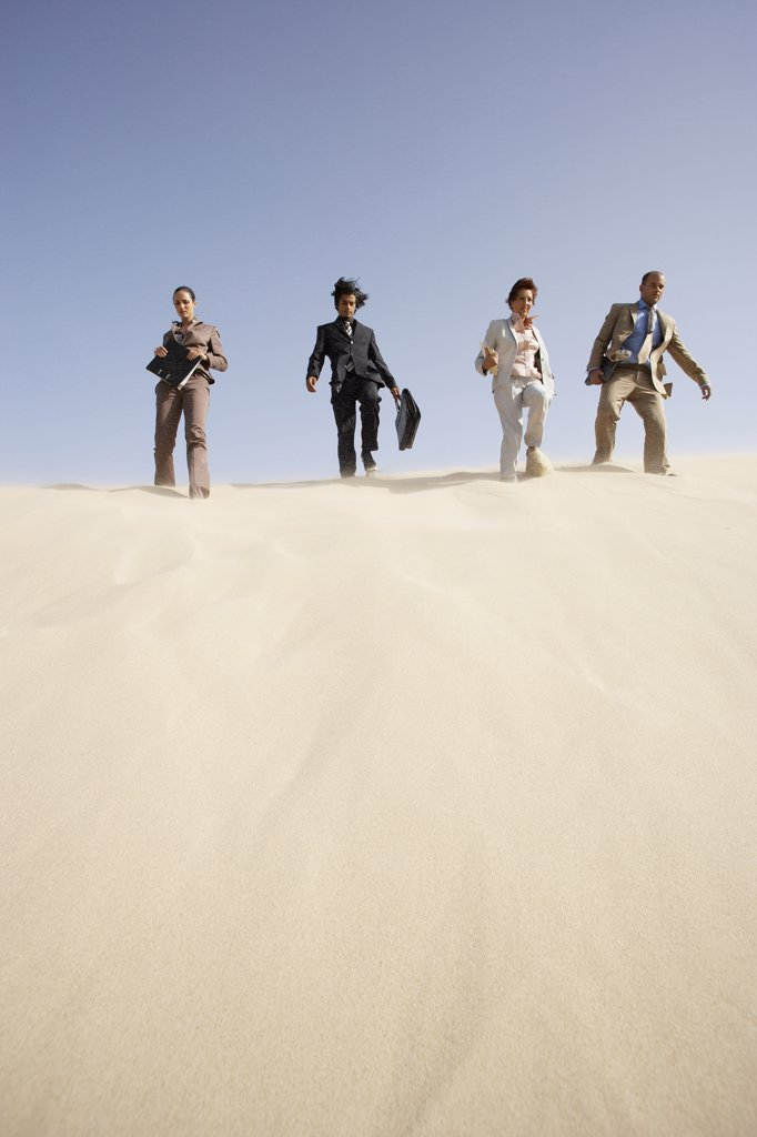 Stock Photo: 1828R-18183 Business People Descending Dune