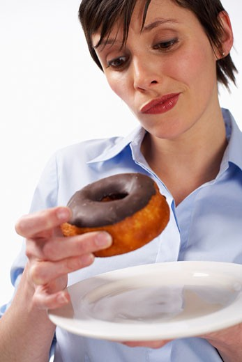 Stock Photo: 1828R-18210 Woman Eating Doughnut