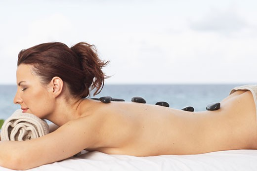 Woman Getting Warming Rock Therapy    : Stock Photo