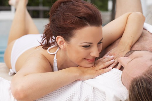 Stock Photo: 1828R-18333 Couple at Side of Pool
