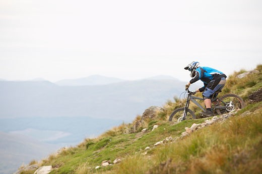 Man Mountain Biking down Hill, Aonach Mor, Scotland    : Stock Photo