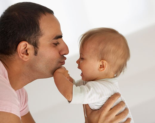 Stock Photo: 1828R-19093 Father Comforting Baby