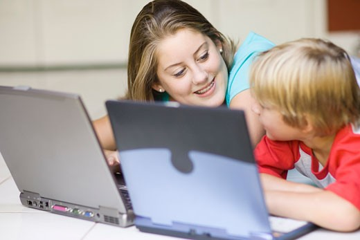 Girl and Boy Using Laptop Computers    : Stock Photo