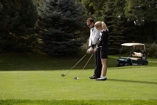Man and Woman Golfing    : Stock Photo