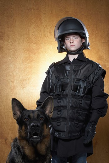 Girl Dressed as Policewoman with Police Dog : Stock Photo