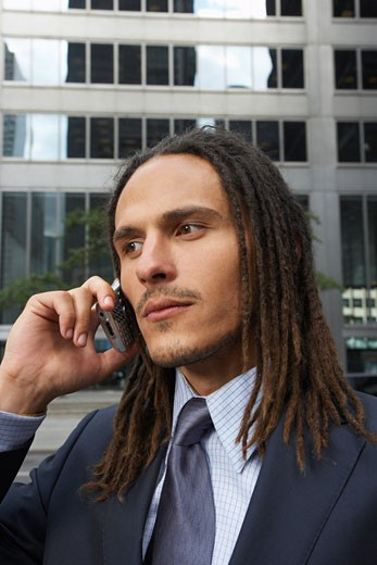 Stock Photo: 1828R-19267 Businessman Using Cellular Phone