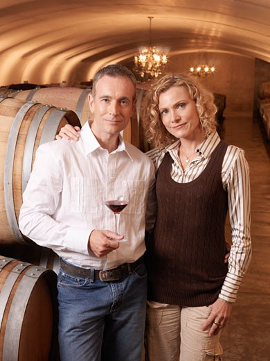 Couple Standing in Wine Cellar    : Stock Photo