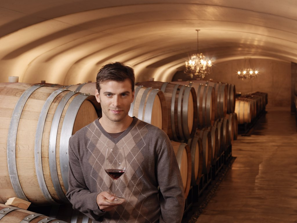 Stock Photo: 1828R-19511 Man Standing in Wine Cellar