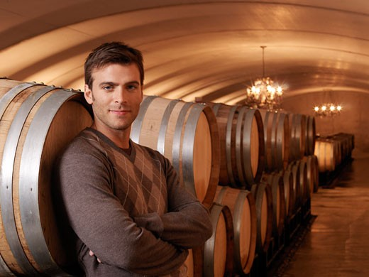 Stock Photo: 1828R-19513 Man Standing in Wine Cellar
