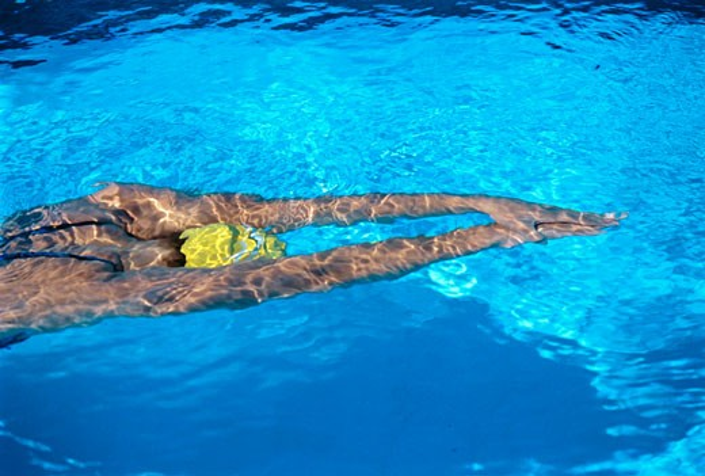 Woman Swimming in Pool    : Stock Photo