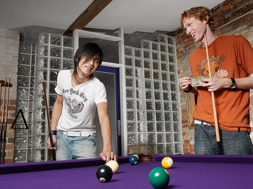 Stock Photo: 1828R-19887 Men Playing Pool