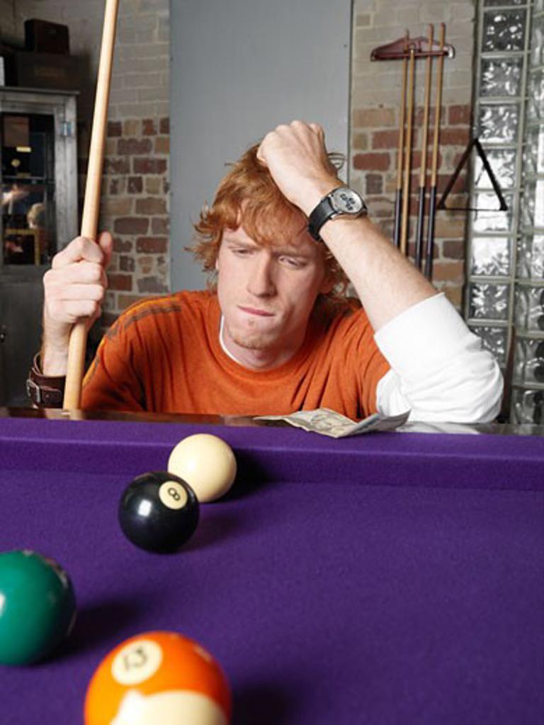 Stock Photo: 1828R-19896 Man Playing Pool