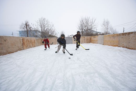 Stock Photo: 1828R-20100 Kids Playing Ice Hockey