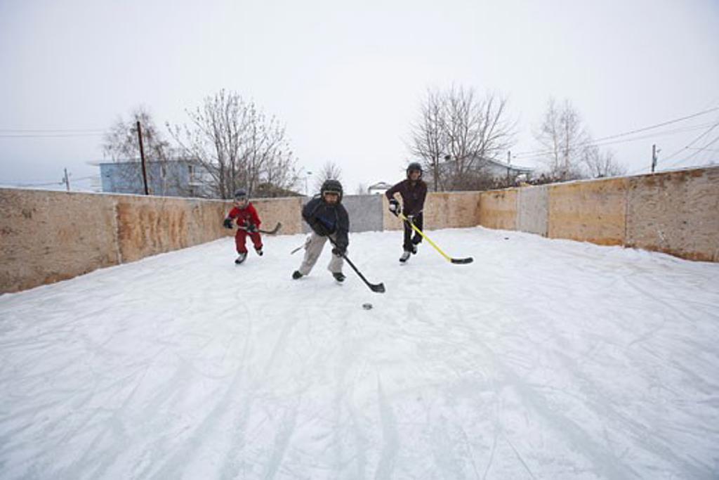 Kids Playing Ice Hockey    : Stock Photo