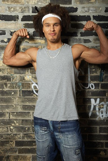 Stock Photo: 1828R-20297 Man Flexing Muscles