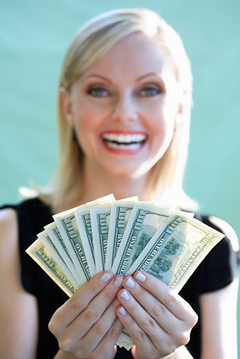 Woman Holding Cash    : Stock Photo