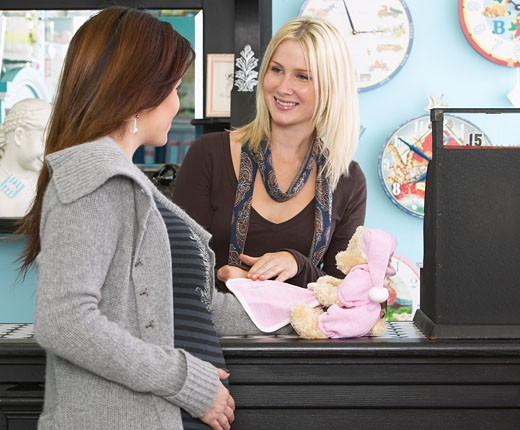 Pregnant Woman Shopping in Baby Store    : Stock Photo