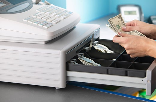 Stock Photo: 1828R-20859 Cashier Counting Money