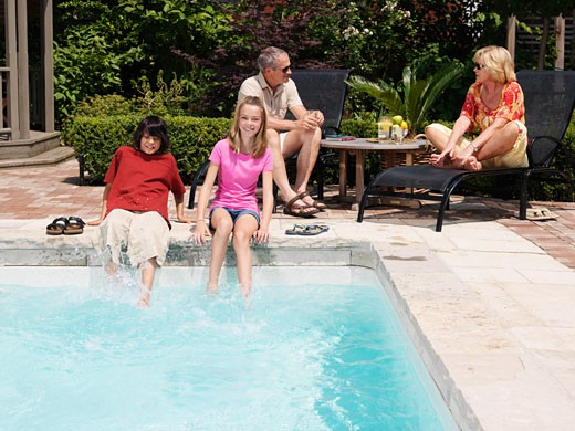 Stock Photo: 1828R-20874 Family Pool Side