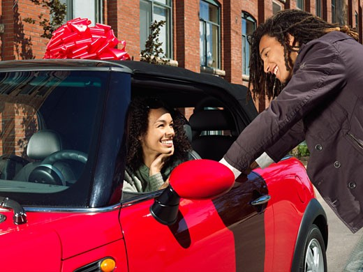Man Giving Woman New Car    : Stock Photo