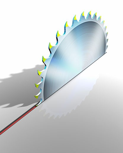 Circular Saw Blade Cutting through Surface    : Stock Photo