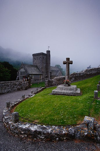 Stock Photo: 1828R-21090 Cross at Graveyard by Church