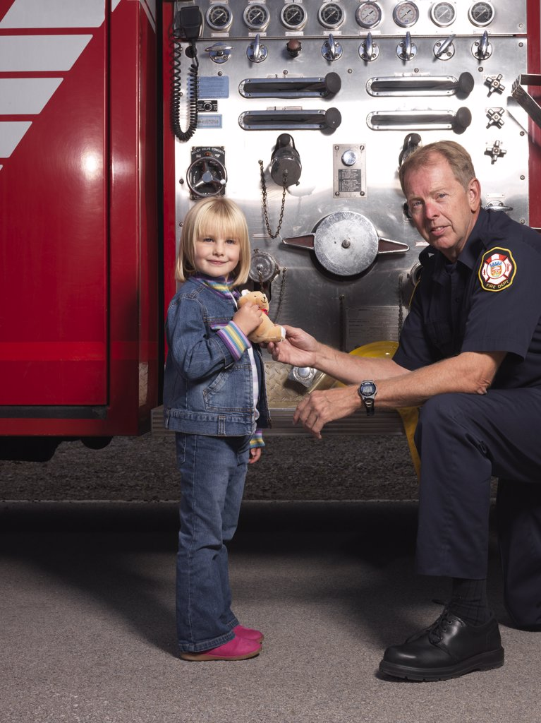 Man and Girl by Fire Truck    : Stock Photo