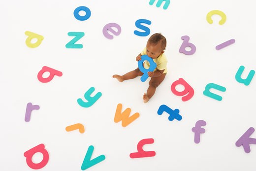 Stock Photo: 1828R-21433 Baby Surrounded by Letters