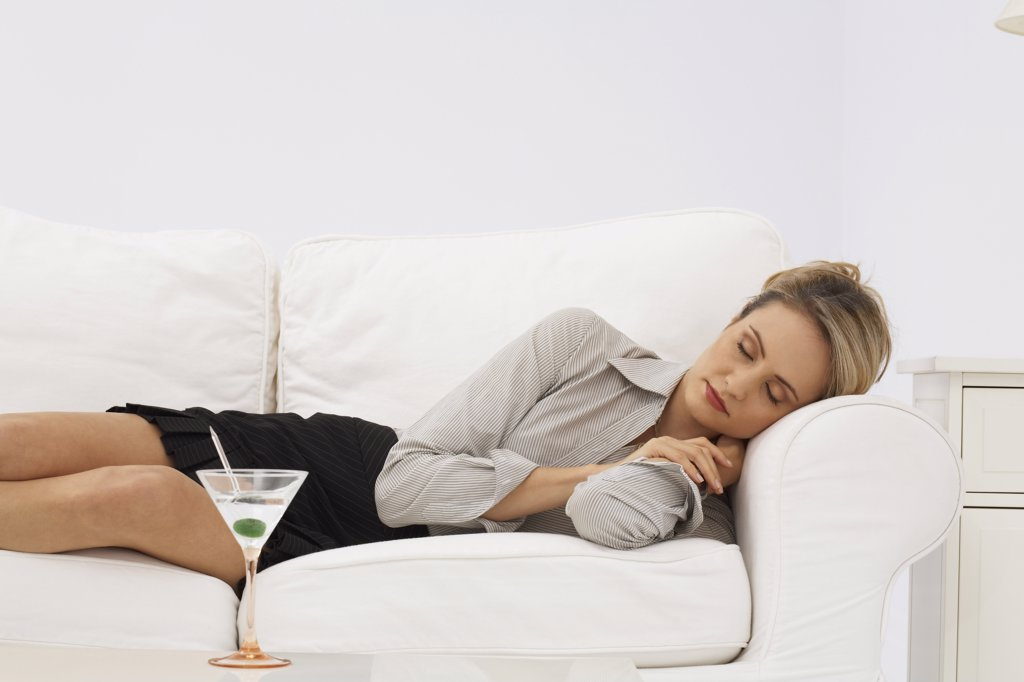 Stock Photo: 1828R-21518 Businesswoman Sleeping on Sofa