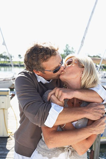 Couple on Dock at Marina    : Stock Photo