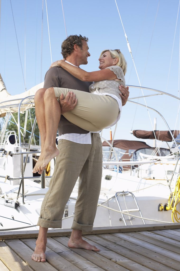 Stock Photo: 1828R-21587 Couple on Dock at Marina