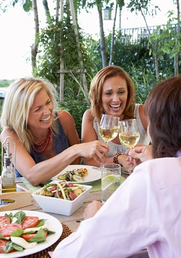 Women Eating Outdoors    : Stock Photo