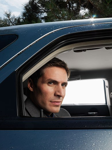 Stock Photo: 1828R-21819 Businessman in Car