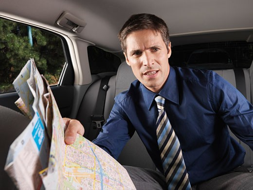 Businessman Holding Map    : Stock Photo