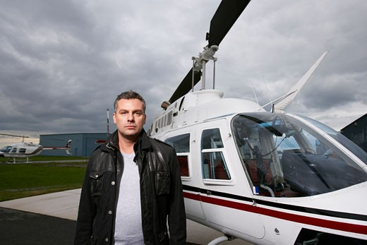 Portrait of Man Beside Helicopter    : Stock Photo