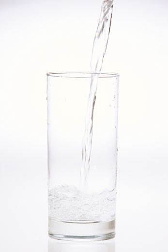 Stock Photo: 1828R-22094 Pouring a Glass of Water