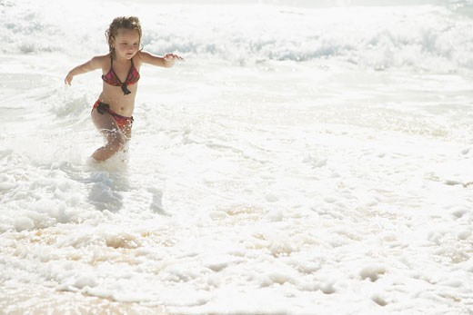 Little Girl Running on the Beach    : Stock Photo