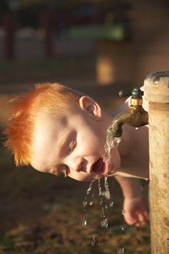 Little Boy Drinking From Tap    : Stock Photo