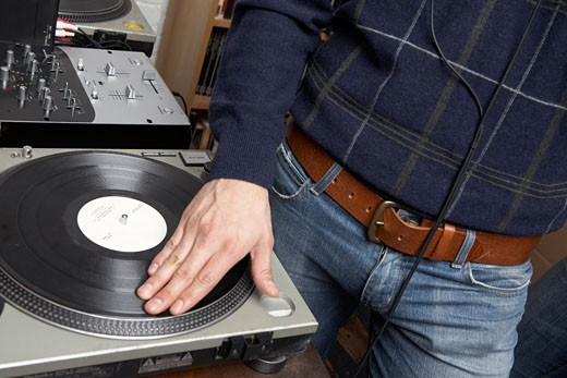 Man Using Turntable    : Stock Photo