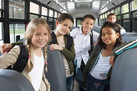 Stock Photo: 1828R-22419 Children on School Bus