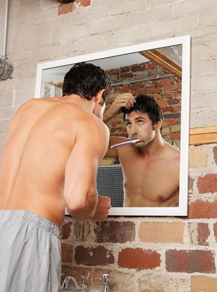 Stock Photo: 1828R-22527 Man Brushing Teeth
