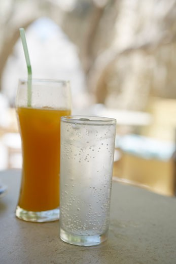 Stock Photo: 1828R-22755 Glasses of Juice and Water on Cafe Table