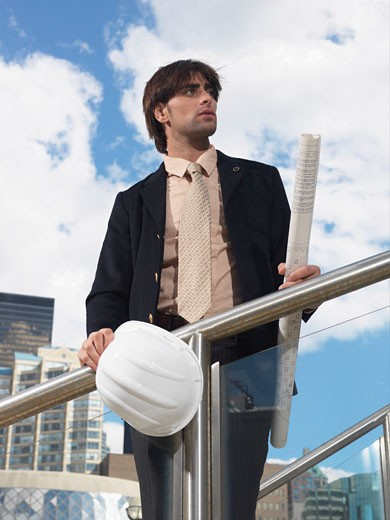Stock Photo: 1828R-22874 Businessman Holding Hard Hat and Blueprints